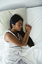 Young woman sleeping in bed - EBSF001583