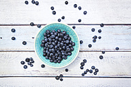 Bowl of blueberries on wood - LVF005188