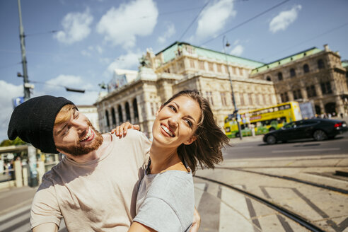 Austria, Vienna, happy young couple dancing Viennese waltz in front of state opera - AIF000357