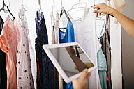 Woman with digital tablet at wardrobe - JRFF000803