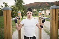 Portrait of a young man, ready to train on a metall bars - RAEF001324