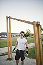 Young man ready to train in park - RAEF001327