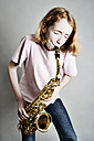 Girl playing saxophone - JATF000865