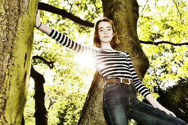 Girl climbing on a tree - JATF000889