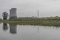 Germany, Lower Saxony, Grohnde, Grohnde Nuclear Power Plant and flock of sheep - PVCF000873