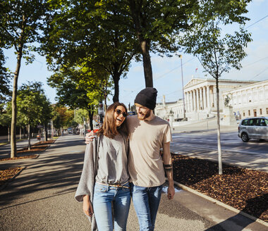 Austria, Vienna,happy  young couple in front of Parliament building - AIF000364