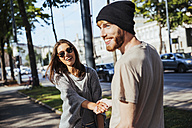 Austria, Vienna, happy young couple on ring road - AIF000367