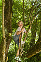 Little boy climbing on a tree in the forest - TCF005030