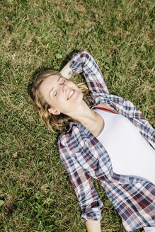 Young woman relaxing on a meadow - GIOF001361