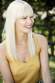 Portrait of smiling blond woman in summer - GDF001087