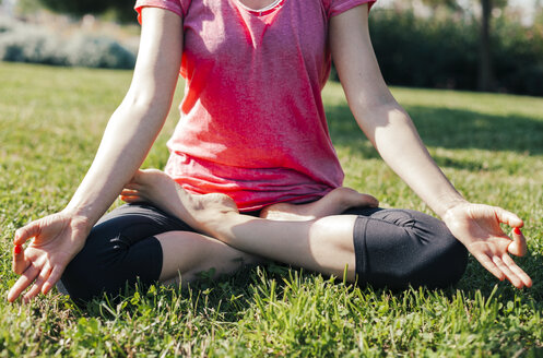 Young woman meditation, lotus position, hands - BZF000323