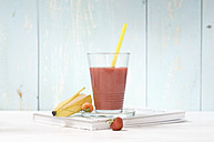 Strawberry banana smoothie in glass with drinking straw - ASF005965