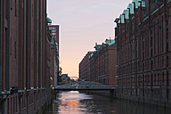 Germany, Hamburg, old warehouse district, canal at sunset - FCF001006
