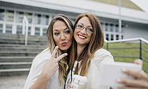 Two women taking selfie with smartphone outdoors - DAPF000228