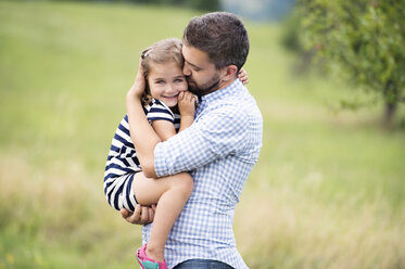 Father holding daughter in his arms - HAPF000698