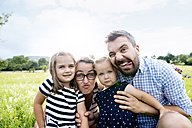 Portrait of family pulling funny faces - HAPF000701
