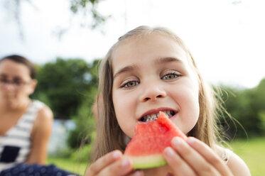 Portrait of little girl eating watermelon - HAPF000707