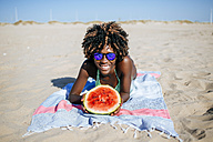 Happy young woman with watermelon on the beach - KIJF000634