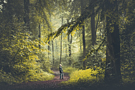 Man on forest path - DWIF000771