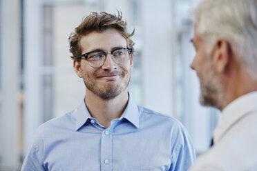 Two businessmen talking together - RORF000219