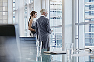 Two business people looking out of the window - RORF000228