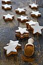 Cinnamon stars and cinnamon powder on wood - ODF001447