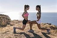 Spain, Asturias, two sportswomen training on the coast - MGOF002175