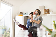 Smiling couple dancing in kitchen - PESF000256