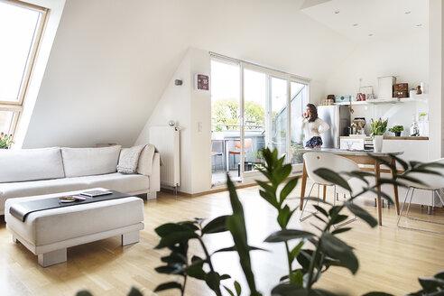 Woman in attic flat - PESF000259