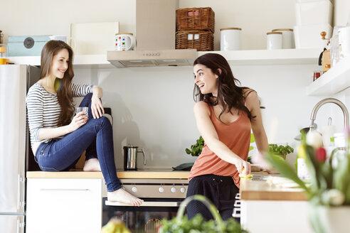 Two happy women in kitchen - PESF000283