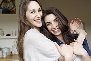 Two happy young women hugging - PESF000304