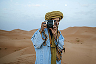 Young Berber taking pictures with camera - KIJF000714