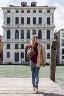 Italy, Venice, back view of tourist on a jetty looking at view - MAUF000717