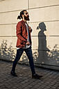 Fashionable young man walking in the city - MAUF000723