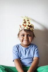 Portrait of smiling little boy wearing self-made headdress - VABF000741