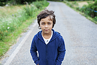 Portrait of little boy standing on a country road - VABF000747