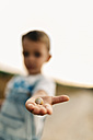 Snail on little boy's palm - JRFF000827