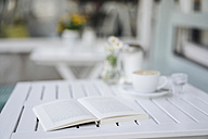 Book on table in a cafe - KNSF000216