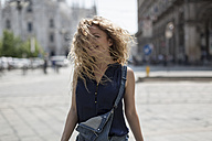 Italy, Milan, smiling young woman tossing her hair - MAUF000808