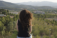 Back view of woman looking at view - SKCF000161