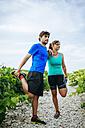 Couple doing sport in a vineyard - KIJF000720