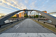 Germany, Hamburg, Niederbaum bridge with Elbe Philharmonic Hall and Hanseatic Trade Center in the morning - RJF000614