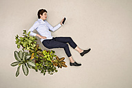 Businesswoman using tablet in nature - BAEF001180
