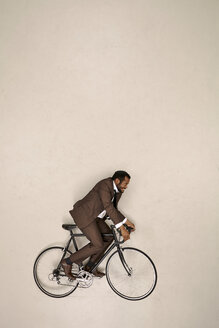 Businessman riding bicycle - BAEF001198