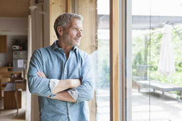 Mature man looking out of window - RBF004854