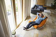 Confident mature man relaxing in armchair - RBF004908