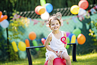 Happy little girl having birthday party in the garden - HAPF000738