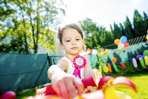 Little girl having birthday party in the garden - HAPF000747