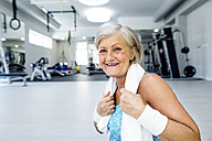 Portrait of smiling mature woman in fitness gym - HAPF000795