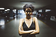 Portrait of young woman in a car park - GIOF001410